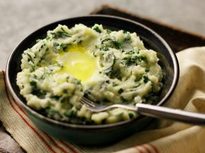 Colcannon Mashed Potatoes are not only delicious but the green color captures the spirit of its Irish heritage.