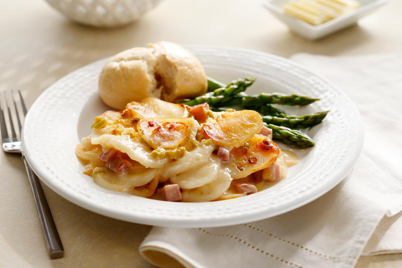 This recipe makes an easy Easter solution by combining ham and scalloped potatoes in one dish.