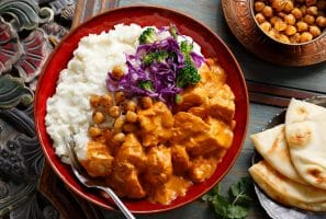 This Indian favorite pairs with Idahoan Mashed Potatoes to make this Butter Chicken Mashed Potato Bowl.