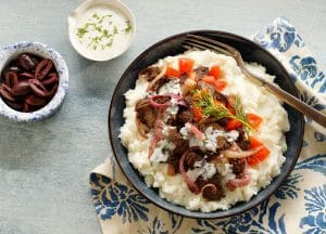 This Greek Mashed Potato Bowl is made with lamb, kalamata olives, sautéed onions, fresh diced tomatoes and, of course, Idahoan mashed potatoes!