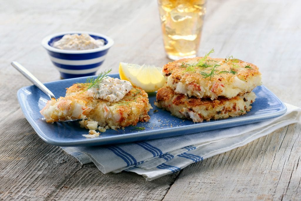 Mashed Potato Crab Cakes are easy to make at home. Using Roasted Garlic Mashed Potatoes gives them a flavor boost from the get-go.