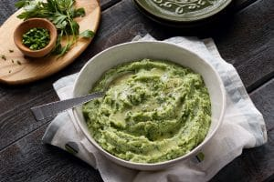 Vibrant and creamy spring green potatoes get a tangy kick from parsley, chives and tarragon.
